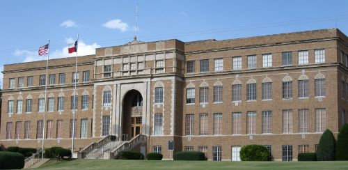 "Front view of the Hutchinson County courthouse. Notice the US flag is on the ""speaker's"" right."