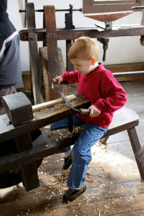 "A homeschooled child learns how things were made back in the ""olden days."" Image courtesy: Susy Morris"